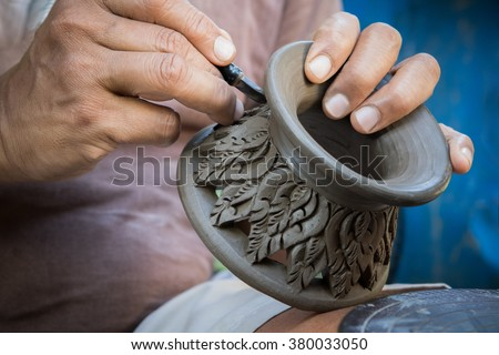 close up potter artist working on clay pottery sculpture fine art in thailand  - stock photo
