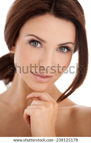 Close up Pretty Young Bare Woman with Green Eyes and Brown Hair  Looking at the Camera. Captured her with One Hand on the Chin. Isolated on White Background. - stock photo