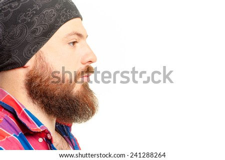 Close up Profile portrait of confident young bearded man looking away isolated on the white - stock photo
