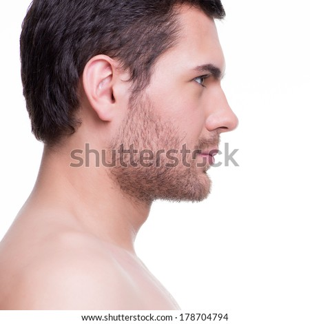 Close-up profile portrait of handsome smiling young man - isolated on white. - stock photo
