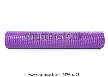Close up purple yoga mat for exercise isolated on over white background - stock photo