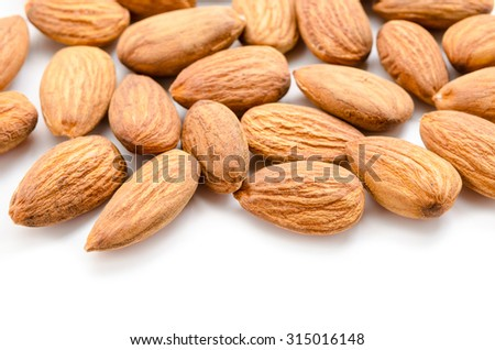 Close up raw almonds on white background.