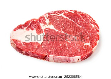 Close up raw beef rib eye steak isolated on white - deep focus image - stock photo