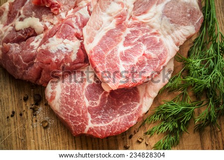 Close up Raw Fresh Meat Slices on Wooden Chopping Board. Ready for Cooking Main Dish - stock photo