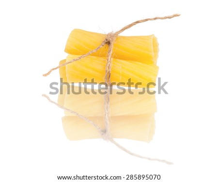Close up raw pasta isolated on white background  - stock photo