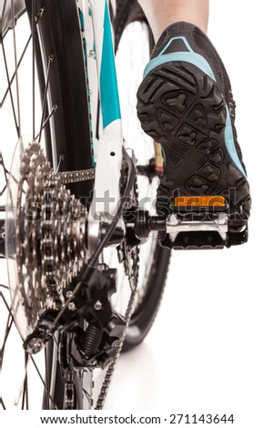 Close up  rear view cyclist pedaling bike  - stock photo