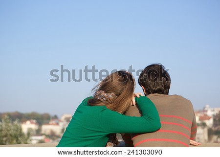 Close up rear view portrait of a young woman leaning on man's shoulder - stock photo