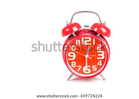 Close up red alarm clock isolated on white background - stock photo
