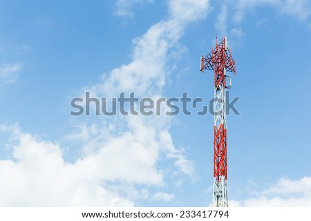 Close up red and white color antenna repeater tower on blue sky - stock photo