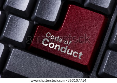 close up red enter button written code of conduct - stock photo