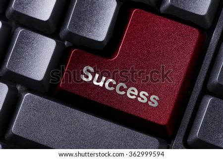 close up red enter button written success - stock photo