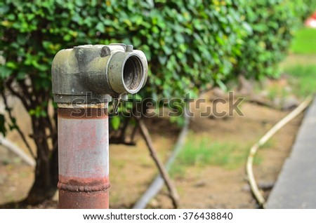 Close up red fire hydrant near a cement wall - stock photo