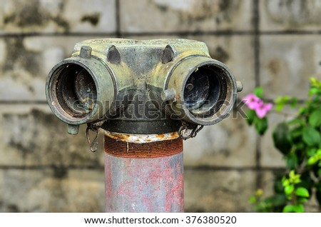 close up red fire hydrant near wall cement - stock photo