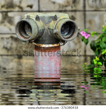 close up red fire hydrant near wall cement with reflect - stock photo