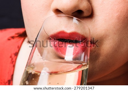 Close up red lip Asian young woman drinking champagne