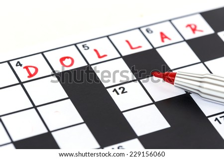 Close up red marker on Crossword - Dollar - stock photo