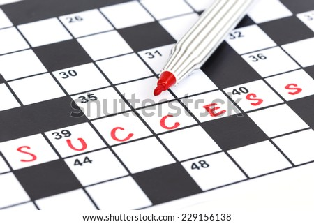 Close up red marker on Crossword - Success - stock photo