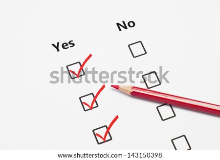 close up red pen and tick YES of check list box isolated on white background - stock photo