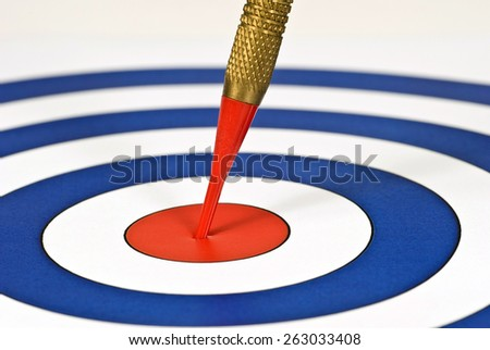Close Up Red Tip Dart Right On Target/ Successful On Target - stock photo
