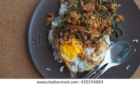 Close up Rice topped with stir fried minced pork and basil,Selective Focus - stock photo