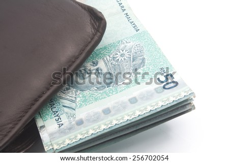 Close up Ringgit Money in leather purse isolated on white background - stock photo
