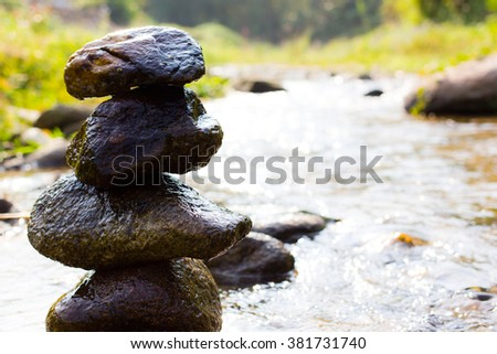 Close up rock tower in the river - stock photo