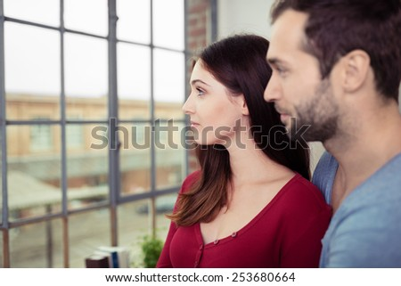 Close up Romantic Young Couple Looking Afar Through Glass Window. - stock photo