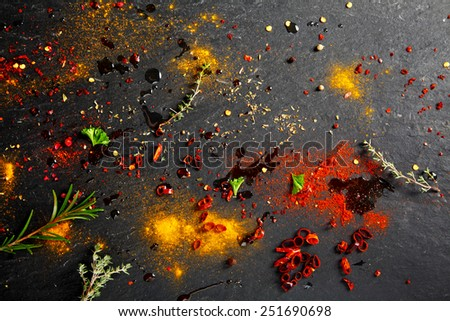 Close up Rub and Marinade Powder and Sauce Scattered on slate Table - stock photo