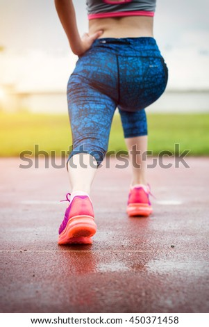 Close up running shoes fitness woman barefoot of slim asian woman while jogging on running track background.
