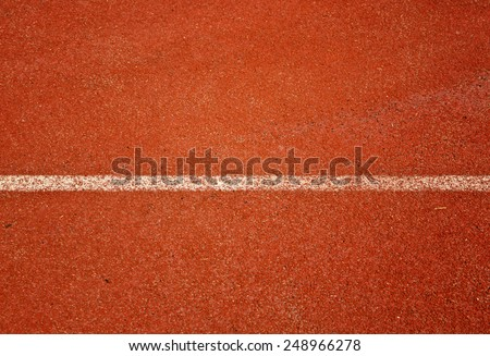 Close up running track for the athletes background - stock photo
