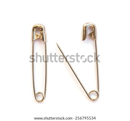 Close up Safety pin isolated on white background - stock photo