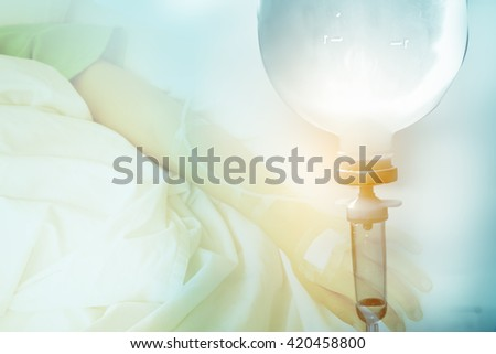 Close up saline IV drip for patient and Infusion pump in hospital. - stock photo