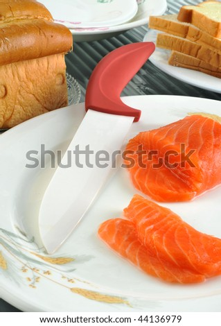 Close-up salmon piece  With ceramic knife