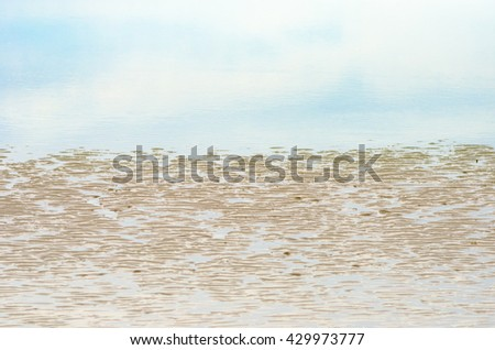 Close up sand beach with reflection of blue sky ,Summer concept
