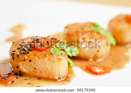 Close up Scallop seafood appetizer with spices - stock photo
