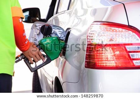 Close up scene of gasoline car refilling - stock photo