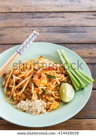 Close up seafood pad Thai dish of Thai fried rice noodles on table - stock photo