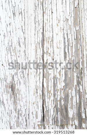 Close Up Section of Old Wood with Peeling White Paint - stock photo