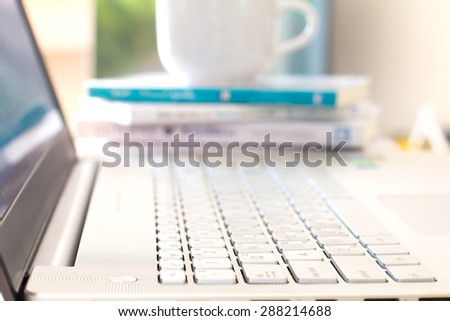 Close up selective focus of  the silver laptop computer - stock photo