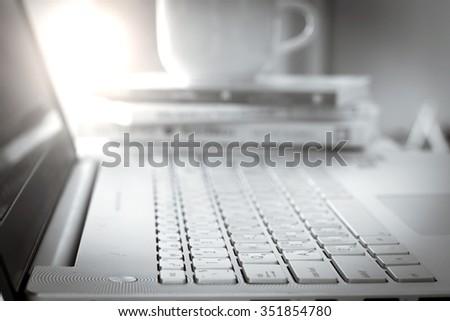 Close up selective focus of  the silver laptop computer, mono color tone - stock photo