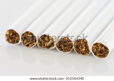 close up set of cigarettes on white background