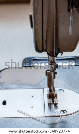 Close up sewing machine with thread on steel needle for ready to sew.