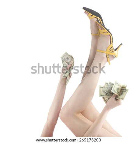 Close up Sexy Woman Raising her Flawless Legs and Arm While Holding Plenty of US Dollars, Isolated on White Background. - stock photo
