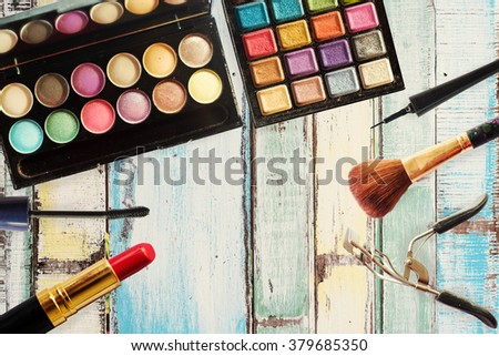 close up shadow kit with brushes for make-up.beauty background. - stock photo