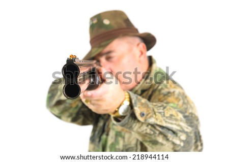 close-up, shallow depth of field shot of a hunter in camouflage pointing a rifle at the camera, isolated on white - stock photo
