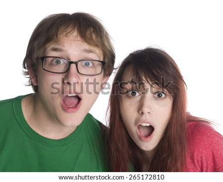 Close up Shocked Young Couple with Mouth and Eyes Wide Open Looking at Camera, Isolated on White Background. - stock photo