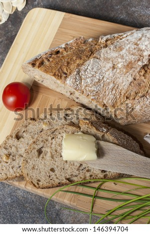 Close up shoot of a sliced bread with a butter