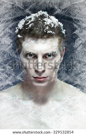 Close up shoot of an young frozen man with ice on a hair, beard and eyelashes - stock photo
