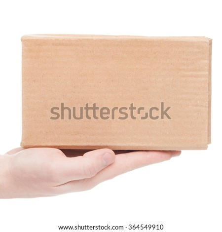 Close up shoot of parcel being delivered to the customer (only one hand and parcel seen) - stock photo
