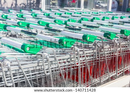 Close up, shopping carts outside of supermarket in rows./shopping carts/shopping - stock photo